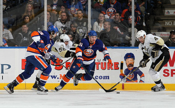 UNIONDALE, NY - FEBRUARY 11:  John Tavares #91 and Matt Moulson #26 of the New York Islanders skate against Zbynek Michalek #4 and Kris Letang #58 of the Pittsburgh Penguins on February 11, 2011 at Nassau Coliseum in Uniondale, New York.  (Photo by Jim Mc