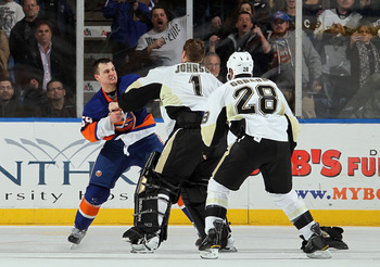 UNIONDALE, NY - FEBRUARY 11:  Micheal Haley #59 of the New York Islanders fights Brent Johnson #1 of the Pittsburgh Penguins in the third period on February 11, 2011 at Nassau Coliseum in Uniondale, New York. The Isles defeated the Pens 9-3.  (Photo by Ji