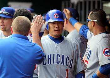 CINCINNATI - AUGUST 29:  Kosuke Fukudome #1 of the Chicago Cubs is congratulated after hitting a home run during the game against the Cincinnati Reds at Great American Ball Park on August 29, 2010 in Cincinnati, Ohio.  (Photo by Andy Lyons/Getty Images)