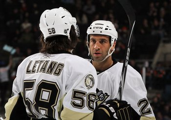 UNIONDALE, NY - FEBRUARY 11:  Maxime Talbot #25 and Kris Letang #58 of the Pittsburgh Penguins skate against the New York Islanders on February 11, 2011 at Nassau Coliseum in Uniondale, New York. The Isles defeated the Pens 9-3.  (Photo by Jim McIsaac/Get
