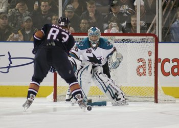 EDMONTON, AB - October 4:  Goaltender Evgeni Nabokov #20 of the San Jose Sharks looks to make a save on Ales Hemsky #83 of the Edmonton Oilers during the NHL game on October 4, 2007 at Rexall Place in Edmonton, Alberta, Canada.  (Photo by Tim Smith/Getty