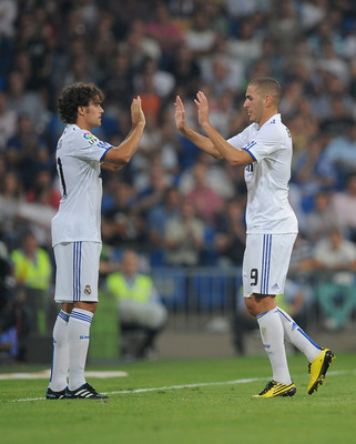 MADRID, SPAIN - SEPTEMBER 11: Karim Benzema (R) of Real Madrid is substituted for teammate Pedro Leon during the La Liga match between Real Madrid and Osasuna at Estadio Santiago Bernabeu on September 11, 2010 in Madrid, Spain.  (Photo by Denis Doyle/Gett