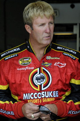 INDIANAPOLIS - JULY 24:  Sterling Marlin, driver of the #09 Miccosukee Indian Gaming & Resort Dodge, stands in the garge during practice for the NASCAR Sprint Cup Series Allstate 400 at the Brickyard at Indianapolis Motor Speedway on July 24, 2009 in Indi