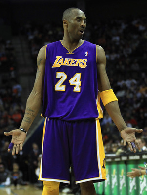 CHARLOTTE, NC - FEBRUARY 14:  Kobe Bryant #24 of the Los Angeles Lakers reacts as he looks to his bench against the Charlotte Bobcats during their game at Time Warner Cable Arena on February 14, 2011 in Charlotte, North Carolina. NOTE TO USER: User expres
