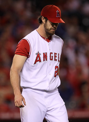 ANAHEIM, CA - SEPTEMBER 06:  Pitcher Dan Haren #24 of the Los Angeles Angels of Anaheim reacts after walking in a run in the sixth inning against the Cleveland Indians on September 6, 2010 at Angel Stadium in Anaheim, California.  (Photo by Stephen Dunn/G