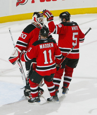 The Devils celebrate Martin Brodeur's 100th career shutout after a 3-0 win against Philadelphia on March 1, 2009.
