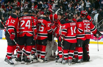 The Devils celebrate an 8-5 victory over the New York Rangers on December 12, 2008.