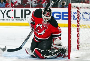 Martin Brodeur makes a save on April 23, 2009, part of a 1-0 victory in Game Five of the 2009 Stanley Cup Eastern Conference Quarterfinals.