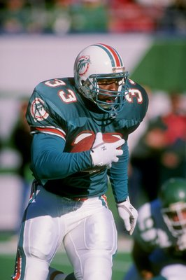 1989-1990:  Running back Sammie Smith of the Miami Dolphins runs with the ball. Mandatory Credit: T. G. Higgins  /Allsport