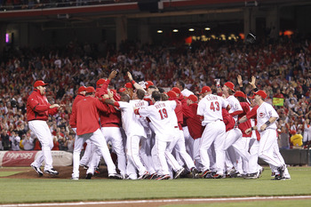 CINCINNATI, OH - SEPTEMBER 28: The Cincinnati Reds celebrate following the game against the Houston Astros at Great American Ball Park on September 28, 2010 in Cincinnati, Ohio. The Reds won 3-2 to clinch the NL Central Division title. (Photo by Joe Robbi