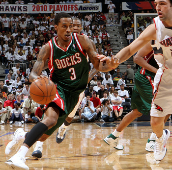 ATLANTA - MAY 2:  Guard Brandon Jennings #3 of the Milwaukee Bucks dribbles past center Zaza Pachulia #27 of the Atlanta Hawks during Game Seven of the Eastern Conference Quarterfinals between the Milwaukee Bucks and the Atlanta Hawks during the 2010 NBA