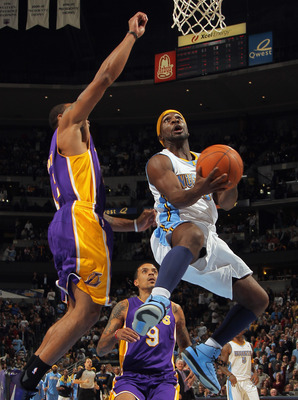 DENVER - NOVEMBER 11:  Ty Lawson #3 of the Denver Nuggets lays up a shot as Shannon Brown #12 of the Los Angeles Lakers defends at the Pepsi Center on November 11, 2010 in Denver, Colorado. The Nuggets defeated the Lakers 118-112.  NOTE TO USER: User expr