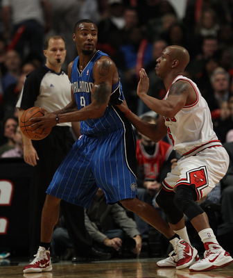 CHICAGO, IL - DECEMBER 01: Rashard Lewis #9 of the Orlando Magic looks to pass under pressure from Keith Bogans #6 of the Chicago Bulls at the United Center on December 1, 2010 in Chicago, Illinois. The Magic defeated the Bulls 107-78. NOTE TO USER: User