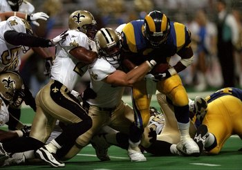 31 Aug 1997:  Running back Lawrence Phillips of the St. Louis Rams runs through the New Orleans defense to score a touchdown during the Rams 38-24 win at the Trans World Dome in St. Louis, Missouri. Mandatory Credit: Stephen Dunn  /Allsport