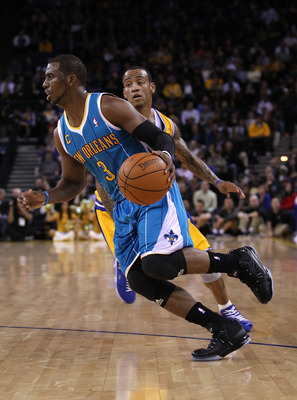 OAKLAND, CA - FEBRUARY 15:  Chris Paul #3 of the New Orleans Hornets drives on Monta Ellis #8 of the Golden State Warriors at Oracle Arena on February 15, 2011 in Oakland, California. NOTE TO USER: User expressly acknowledges and agrees that, by downloadi