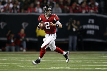 ATLANTA, GA - JANUARY 15:  Quarterback Matt Ryan #2 of the Atlanta Falcons rolls out to pass against the Green Bay Packers during their 2011 NFC divisional playoff game at Georgia Dome on January 15, 2011 in Atlanta, Georgia. The Packers won 48-21.  (Phot