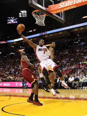 MIAMI, FL - JANUARY 31:  Dwyane Wade #3 of the Miami Heat drives the lane during a game against the Cleveland Cavaliers at American Airlines Arena on January 31, 2011 in Miami, Florida. NOTE TO USER: User expressly acknowledges and agrees that, by downloa