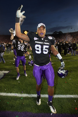 PASADENA, CA - JANUARY 01:  Clarence Leatch #95 of the TCU Horned Frogs celebrates after defeating the Wisconsin Badgers 21-19 in the 97th Rose Bowl game on January 1, 2011 in Pasadena, California.  (Photo by Stephen Dunn/Getty Images)