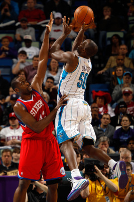 NEW ORLEANS, LA - JANUARY 03:  Emeka Okafor #50 of the New Orleans Hornets shoots over Elton Brand #42 of the Philadelphia 76ers in the second half at New Orleans Arena on January 3, 2011 in New Orleans, Louisiana. NOTE TO USER: User expressly acknowledge