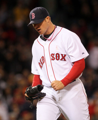 BOSTON - MAY 9:  Jon Lester #31 of the Boston Red Sox reacts in the sixth inning against the New York Yankees at Fenway Park on May 9, 2010 in Boston, Massachusetts. (Photo by Jim Rogash/Getty Images)
