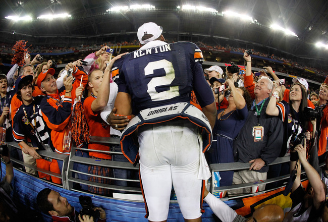 GLENDALE, AZ - JANUARY 10:  Quarterback Cameron Newton #2 of the Auburn Tigers celebrates the Tigers 22-19 victory with the fans after defeating the Oregon Ducks in the Tostitos BCS National Championship Game at University of Phoenix Stadium on January 10