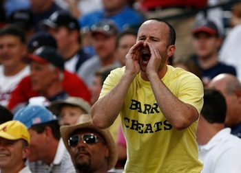 ATLANTA - AUGUST 14:  An unidentified fan yells at Barry Bonds with a 'Barry Cheats' t-shirt on during the game between the Atlanta Braves and the San Francisco Giants at Turner Field August 14, 2007 in Atlanta, Georgia.  (Photo by Mike Zarrilli/Getty Ima