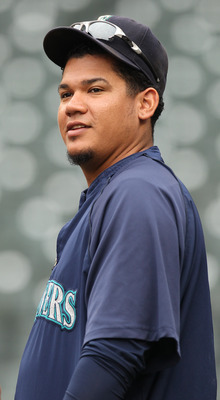 SEATTLE - SEPTEMBER 15:  Pitcher Felix Hernandez #34 of the Seattle Mariners looks on during batting practice prior to the game  against the Boston Red Sox at Safeco Field on September 15, 2010 in Seattle, Washington. (Photo by Otto Greule Jr/Getty Images