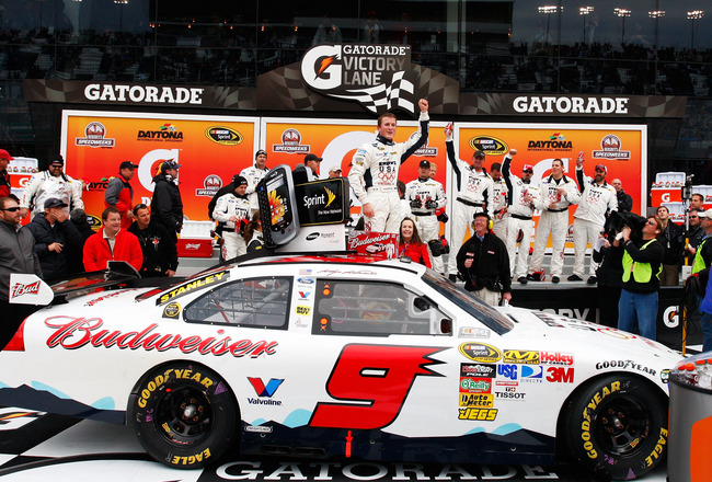 DAYTONA BEACH, FL - FEBRUARY 11:  Kasey Kahne, driver of the #9 Budweiser Ford, celebrates in victory lane after winning the second NASCAR Sprint Cup Series Gatorade Duel at Daytona International Speedway on February 11, 2010 in Daytona Beach, Florida.  (