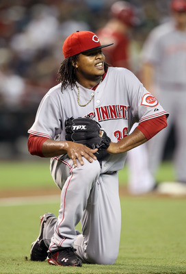 PHOENIX - AUGUST 18:  Starting pitcher Edinson Volquez #36 of the Cincinnati Reds reacts after fielding a ground ball out against the Arizona Diamondbacks during the Major League Baseball game at Chase Field on August 18, 2010 in Phoenix, Arizona.  (Photo