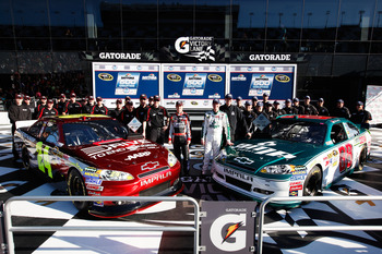 DAYTONA BEACH, FL - FEBRUARY 13:  Front Row award winner Jeff Gordon, driver of the #24 Drive to End Hunger Chevrolet, and Pole award winner Dale Earnhardt Jr., driver of the #88 National Guard/AMP Energy Chevrolet, pose with their teams in victory lane a