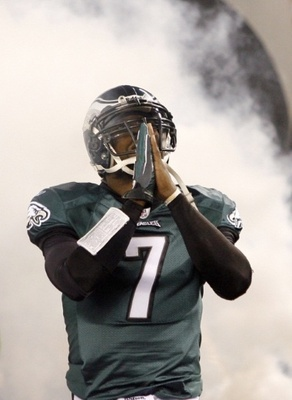 Michael Vick prays to the Gods of Dog heaven for forgiveness