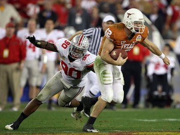 GLENDALE, AZ - JANUARY 05:  Quarterback Colt McCoy #12 of the Texas Longhorns scrambles from Thaddeus Gibson #90 of the Ohio State Buckeyes in the Tostitos Fiesta Bowl Game on January 5, 2009 at University of Phoenix Stadium in Glendale, Arizona. The Long