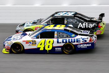 DAYTONA BEACH, FL - FEBRUARY 11:  Jimmie Johnson, driver of the #48 Lowe's Chevrolet, races Carl Edwards, driver of the #99 Aflac Ford, during the first NASCAR Sprint Cup Series Gatorade Duel at Daytona International Speedway on February 11, 2010 in Dayto