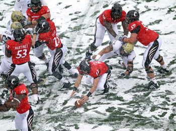CINCINNATI, OH - DECEMBER 04:  Zach Collaros #12 of the Cincinnati Bearcats reaches for a fumble during the Big East Conference game against the Pittsburgh Panthers at Nippert Stadium on December 4, 2010 in Cincinnati, Ohio. Pittsburgh won 28-10.  (Photo