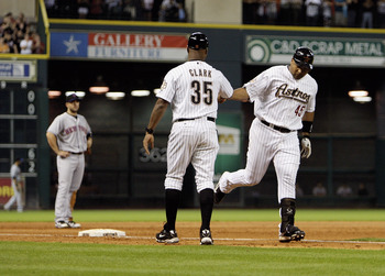 HOUSTON - AUGUST 19:  Carlos Lee #45 of the Houston Astros is congratulated by third base coach Dave Clark #35 after hitting a three run home run in the seventh inning against the New York Mets at Minute Maid Park on August 19, 2010 in Houston, Texas.  (P