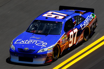 DAYTONA BEACH, FL - FEBRUARY 12:  Kevin Conway, driver of the #97 ExtenZe Toyota, practices for the NASCAR Sprint Cup Series Daytona 500 at Daytona International Speedway on February 12, 2011 in Daytona Beach, Florida.  (Photo by Chris Graythen/Getty Imag