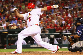 ST. LOUIS - SEPTEMBER 16: Albert Pujols #5 of the St. Louis Cardinals hits an RBI double against the San Diego Padres at Busch Stadium on September 16, 2010 in St. Louis, Missouri.  (Photo by Dilip Vishwanat/Getty Images)
