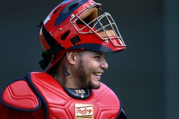 JUPITER, FL - FEBRUARY 16:  Catcher Yadier Molina #4 of the St. Louis Cardinals trains at Roger Dean Stadium on February 16, 2011 in Jupiter, Florida.  (Photo by Marc Serota/Getty Images)
