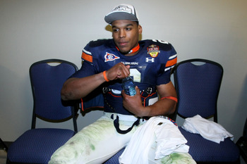 GLENDALE, AZ - JANUARY 10: Quarterback Cameron Newton #2 of the Auburn Tigers drinks water in the hallway minutes after the Tigers 22-19 victory against the Oregon Ducks in the Tostitos BCS National Championship Game at University of Phoenix Stadium on Ja