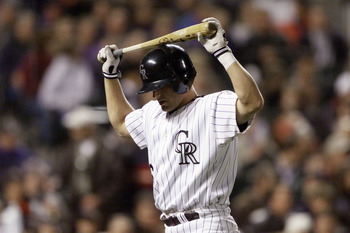 13 Apr 2001:  Ben Petrick #6 of the Colorado Rockies holds his bat on his head after striking out against pitcher Randy Johnson of the Arizona Diamondbacks at Coors Field in Denver, Colorado.  <DIGITAL IMAGE> Mandatory Credit: Brian Bahr/ALLSPORT