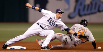 ST. PETERSBURG, FL - SEPTEMBER 29:  Infielder Ben Zobrist #18 of the Tampa Bay Rays stretches for the throw as Adam Jones #10 of the Baltimore Orioles slides safely into second during the game at Tropicana Field on September 29, 2010 in St. Petersburg, Fl