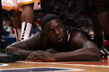 NEW YORK - MARCH 11: Lance Stephenson #33 of the Cincinnati Bearcats lays on the court after a play late in the game against the West Virginia Mountaineers during the quarterfinal of the 2010 NCAA Big East Tournament at Madison Square Garden on March 11,