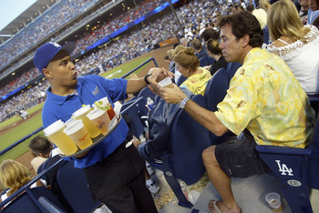 LOS ANGELES, CA - JULY 26: (U.S. TABS AND HOLLYWWOD REPORTER OUT)  Dodger fan Pat Theodora buys a beer in 'The Dugout Club' at Dodger Stadium on July 26, 2005 in Los Angeles California. (Photo by Matthew Simmons/Getty Images)