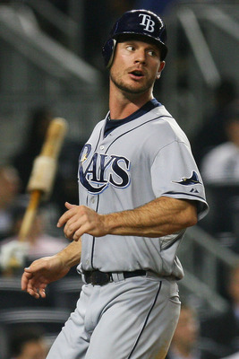 NEW YORK - SEPTEMBER 22:  John Jaso #28 of the Tampa Bay Rays scores a run off of Carl Crawford's one run single in the fifth inning against the New York Yankees on September 22, 2010 at Yankee Stadium in the Bronx borough of New York City.  (Photo by And