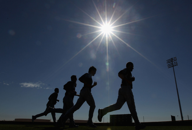 PEORIA, AZ - FEBRUARY 15:  Players from the Seattle Mariners take running drills during a MLB spring training practice at Peoria Stadium on February 15, 2011 in Peoria, Arizona.  (Photo by Christian Petersen/Getty Images)