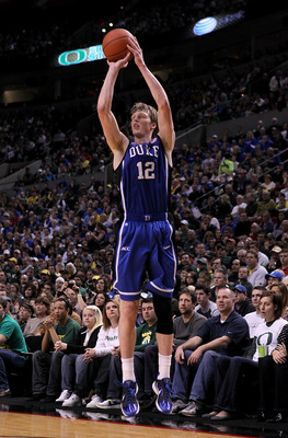 PORTLAND, OR - NOVEMBER 27:  Kyle Singler #12 of the Duke Blue Devils shoots a three pointer against the Oregon Ducks on November 27, 2010 at the Rose Garden in Portland, Oregon.  (Photo by Jonathan Ferrey/Getty Images)