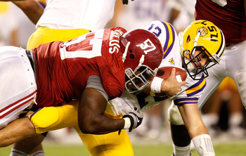 TUSCALOOSA, AL - NOVEMBER 07:  Marcell Dareus #57 of the Alabama Crimson Tide sacks quarterback Jarrett Lee #12 of the Louisiana State University Tigers at Bryant-Denny Stadium on November 7, 2009 in Tuscaloosa, Alabama.  (Photo by Kevin C. Cox/Getty Imag