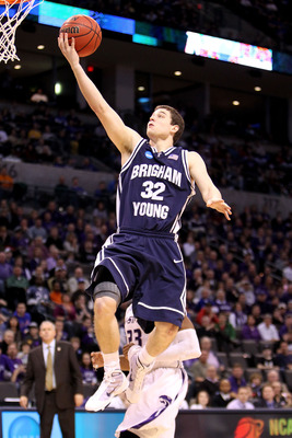 OKLAHOMA CITY - MARCH 20:  Jimmer Fredette #32 of the Brigham Young Cougars drives for a shot attempt against the Kansas State Wildcats during the second round of the 2010 NCAA men's basketball tournament at Ford Center on March 20, 2010 in Oklahoma City,