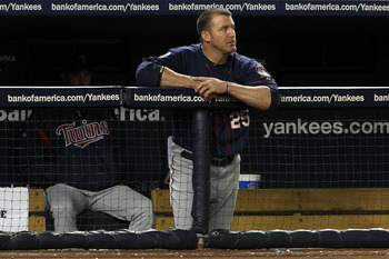 NEW YORK - OCTOBER 09:  Jim Thome #25 of the Minnesota Twins looks on dejected from the dugout against the New York Yankees  during Game Three of the ALDS part of the 2010 MLB Playoffs at Yankee Stadium on October 9, 2010 in the Bronx borough of New York