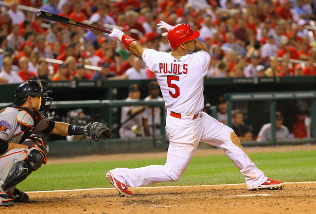 ST. LOUIS, MO - MAY 31: Albert Pujols #5 of the St. Louis Cardinals hits an RBI double against the San Francisco Giants at Busch Stadium on May 31, 2011 in St. Louis, Missouri.  (Photo by Dilip Vishwanat/Getty Images)